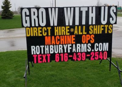 Portable signs looking for new staff in Grand Rapids