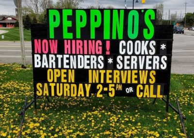 Peppino's Sports Bar in Jenison using a neon lettered black sign to find great new people
