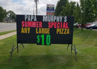 Light Bright Signs portable black signs on the road in Jension promoting a special for Papa Murphy's Pizza with a colorfully letters