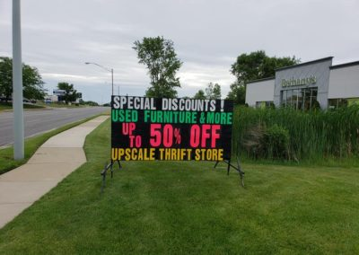 Bethany's Thrift & Consignment Store in Kentwood, Michigan using a Light Bright portable black sign to sell used furniture!