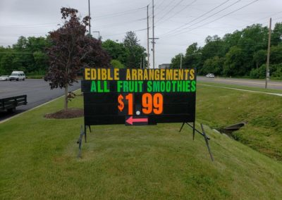 Edible Arrangements Grandville, MI using a Light Bright portable black sign to promote smoothies! YUM!