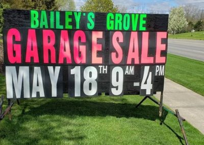 Bailey's Grove in Kentwood, Michigan promoting garage sales with a portable black sign