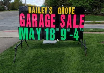 Bailey's Grove in Kentwood, Michigan promoting garage sales with neon lettered signs