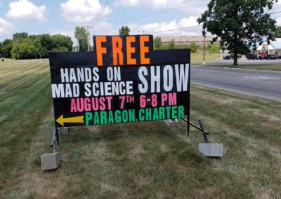 Michigan's leader in black signs in Jackson, MI at the Paragon Charter School advertising a free science event