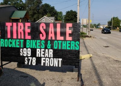 Grand Rapids area autmotive retailer uses a Light Bright custom portable sign to promote a tire- Michigan's leader in black signs!