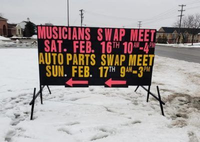 Light Bright Signs- Musicians Swap Meet at the Four Mile Show Place using a black sign