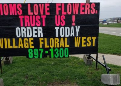 Village Floral in Lowell and Michigan black sign leader Light Bright Signs