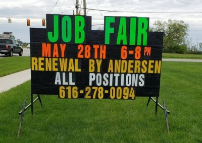 Kentwood job fair advertising with a portable black sign