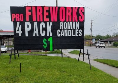 Seasonal sales for Fireworks using a portable neon lettered Light Bright Sign