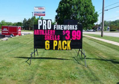 Black signs selling fireworks!