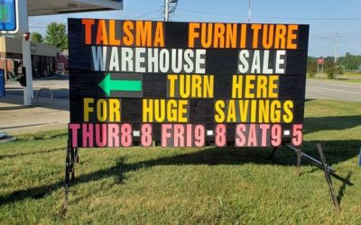 Furniture Stores advertising with a black sign with big neon letters